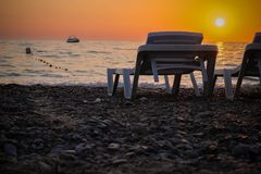 Sunset on the beach. Beautiful sunset on the warm beach of the côte d`azur Stock Images