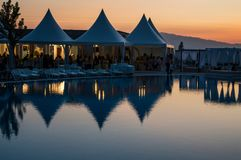 Beautiful sunset water reflection. Sunset water reflection with tents near to the pool Stock Photos