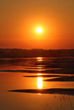 Beautiful sunset with waved river sand beach Royalty Free Stock Image