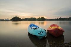 Beautiful sunset at Wetland , Putrajaya. Amazing sunset at Putrajaya with jetty and nice arrangement of canoes Royalty Free Stock Photo