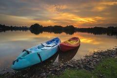 Beautiful sunset at Wetland , Putrajaya. Amazing sunset at Putrajaya with jetty and nice arrangement of canoes Royalty Free Stock Photography
