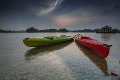 Beautiful sunset at Wetland , Putrajaya. Amazing sunset at Putrajaya with jetty and nice arrangement of canoes Stock Image