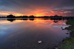 Beautiful sunset at Wetland , Putrajaya. Amazing sunset at Putrajaya with jetty and nice arrangement of canoes Royalty Free Stock Photos