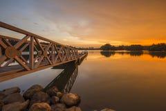 Beautiful sunset at Wetland , Putrajaya. Amazing sunset at Putrajaya with jetty and nice arrangement of canoes Royalty Free Stock Images