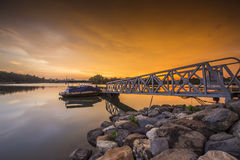 Beautiful sunset at Wetland , Putrajaya. Amazing sunset at Putrajaya with jetty and nice arrangement of canoes Stock Photo