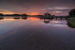 Beautiful sunset at Wetland , Putrajaya. Amazing sunset at Putrajaya with jetty and nice arrangement of canoes Stock Photos