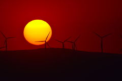 Beautiful sunset with wind turbines on the hill Royalty Free Stock Photos