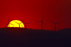 Beautiful sunset with wind turbines on the hill Stock Image