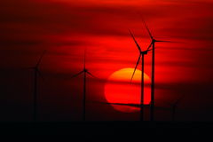 Beautiful sunset with wind turbines on the hill in summer Royalty Free Stock Image