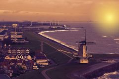Beautiful sunset at the windmill of Vlissingen, city skyline of a popular town in the evening, Zeeland, The Netherlands stock photography