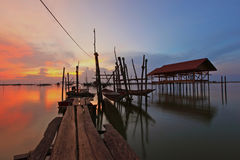 Beautiful sunset. With wooden bridge at the lake Stock Photo