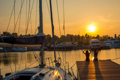 Beautiful sunset at the yacht club. Royalty Free Stock Photos