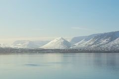 Beautiful Sunshine over mountain snow with waterfront Stock Photo