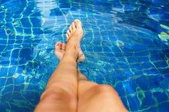 Beautiful Suntan Female Legs in Swimming Pool Stock Photography