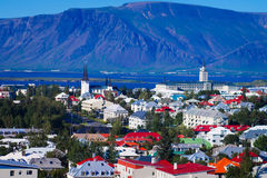 Beautiful super wide-angle aerial view of Reykjavik, Iceland wit. H harbor and skyline mountains and scenery beyond the city, seen from the observation tower of Stock Photos