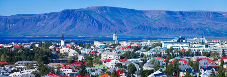 Beautiful super wide-angle aerial view of Reykjavik, Iceland. With harbor and skyline mountains and scenery beyond the city, seen from the observation tower of Stock Photography