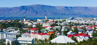 Beautiful super wide-angle aerial view of Reykjavik, Iceland wit. H harbor and skyline mountains and scenery beyond the city, seen from the observation tower of Stock Images