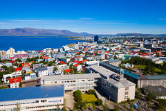 Beautiful super wide-angle aerial view of Reykjavik, Iceland wit. H harbor and skyline mountains and scenery beyond the city, seen from the observation tower of Stock Image