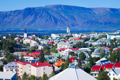 Beautiful super wide-angle aerial view of Reykjavik, Iceland wit. H harbor and skyline mountains and scenery beyond the city, seen from the observation tower of Stock Photography