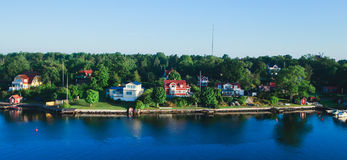 Beautiful super wide-angle aerial view of Stockholm archipelago skerries and suburbs with classic sweden scandinavian designed cot. Tage houses, view from Royalty Free Stock Images