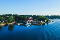 Beautiful super wide-angle aerial view of Stockholm archipelago skerries and suburbs with classic sweden scandinavian designed cot. Tage houses, view from Royalty Free Stock Photo