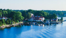 Beautiful super wide-angle aerial view of Stockholm archipelago skerries and suburbs with classic sweden scandinavian designed cot. Tage houses, view from Royalty Free Stock Image
