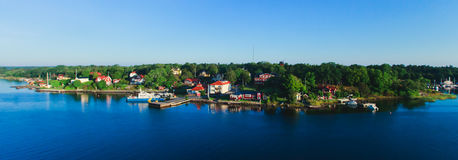 Beautiful super wide-angle aerial view of Stockholm archipelago skerries and suburbs with classic sweden scandinavian designed cot Stock Photo