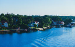 Beautiful super wide-angle aerial view of Stockholm archipelago skerries and suburbs with classic sweden scandinavian designed cot. Tage houses, view from Royalty Free Stock Photography