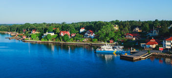 Beautiful super wide-angle aerial view of Stockholm archipelago skerries and suburbs with classic sweden scandinavian designed cot Stock Photos