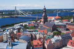 Beautiful super wide-angle panoramic aerial view of Riga, Latvia with harbor and skyline with scenery beyond the city Stock Photos