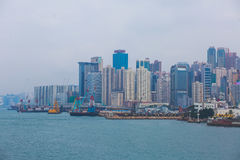 Beautiful super wide-angle summer aerial view of Hong Kong island skyline, Victoria Bay harbor, with skyscrapers, blue sky Stock Photography