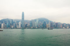 Beautiful super wide-angle summer aerial view of Hong Kong island skyline, Victoria Bay harbor, with skyscrapers, blue sky Royalty Free Stock Image