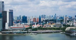 Beautiful super wide-angle summer aerial view of Singapore, with skyline, bay and scenery beyond the city, seen from the observati. On deck Royalty Free Stock Image