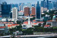 Beautiful super wide-angle summer aerial view of Singapore, with skyline, bay and scenery beyond the city, seen from the observati. On deck Royalty Free Stock Photos
