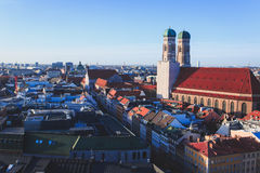 Beautiful super wide-angle sunny aerial view of Munich, Bayern, Bavaria, Germany with skyline and scenery beyond the city, seen fr Stock Photo