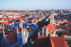 Beautiful super wide-angle sunny aerial view of Munich, Bayern, Bavaria, Germany with skyline and scenery beyond the city, seen fr Stock Images