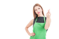 Beautiful supermarket saleswoman doing money gesture. Beautiful supermarket saleswoman doing a money gesture as payment concept isolated on white with Stock Photos