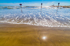 Beautiful Surf and Sand on a Summertime Ocean Beach. Royalty Free Stock Image