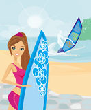 Beautiful surfer girl on a beach Royalty Free Stock Images