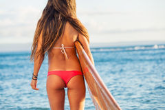 Beautiful surfer girl in sexy bikini Royalty Free Stock Photography