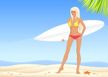Beautiful surfer girl on the sunny beach Stock Images