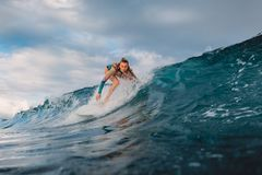 Beautiful surfer girl on surfboard. Woman in ocean during surfing. Surfer and barrel wave royalty free stock images