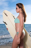 Beautiful surfer woman near the seaside Royalty Free Stock Photos