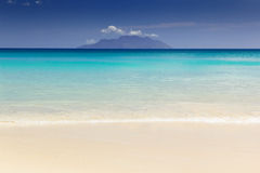 Beautiful surfing tropical sand beach. On sunny summer day Royalty Free Stock Photos