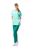 Beautiful surgeon portrait in green dress Royalty Free Stock Image