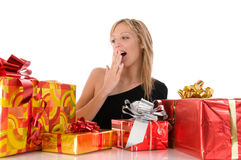 Beautiful surprise girl looks colorful gifts Royalty Free Stock Images