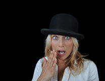 Beautiful surprised blonde woman. Beautiful surprised blonde woman wearing a hat on a black background with room for text Royalty Free Stock Photography