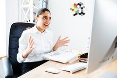 Beautiful surprised businesswoman looking at laptop Stock Photos