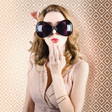 Beautiful surprised girl wearing big sunglasses Stock Image