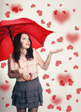 Beautiful surprised valentine's  girl with umbrella in love. Stock Photography